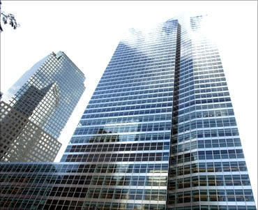 Clouds are reflected on the outside of the Goldman Sachs building.