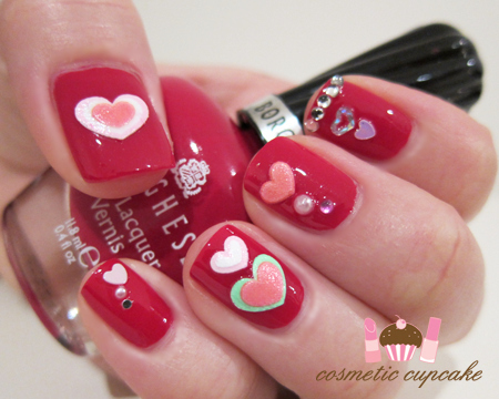 This quirky look was created with nail stickers and rhinestones
