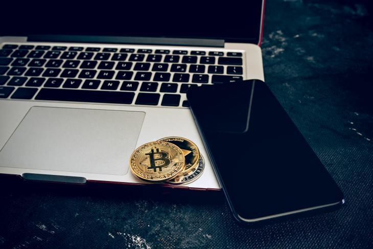 The golden bitcoin on keyboard