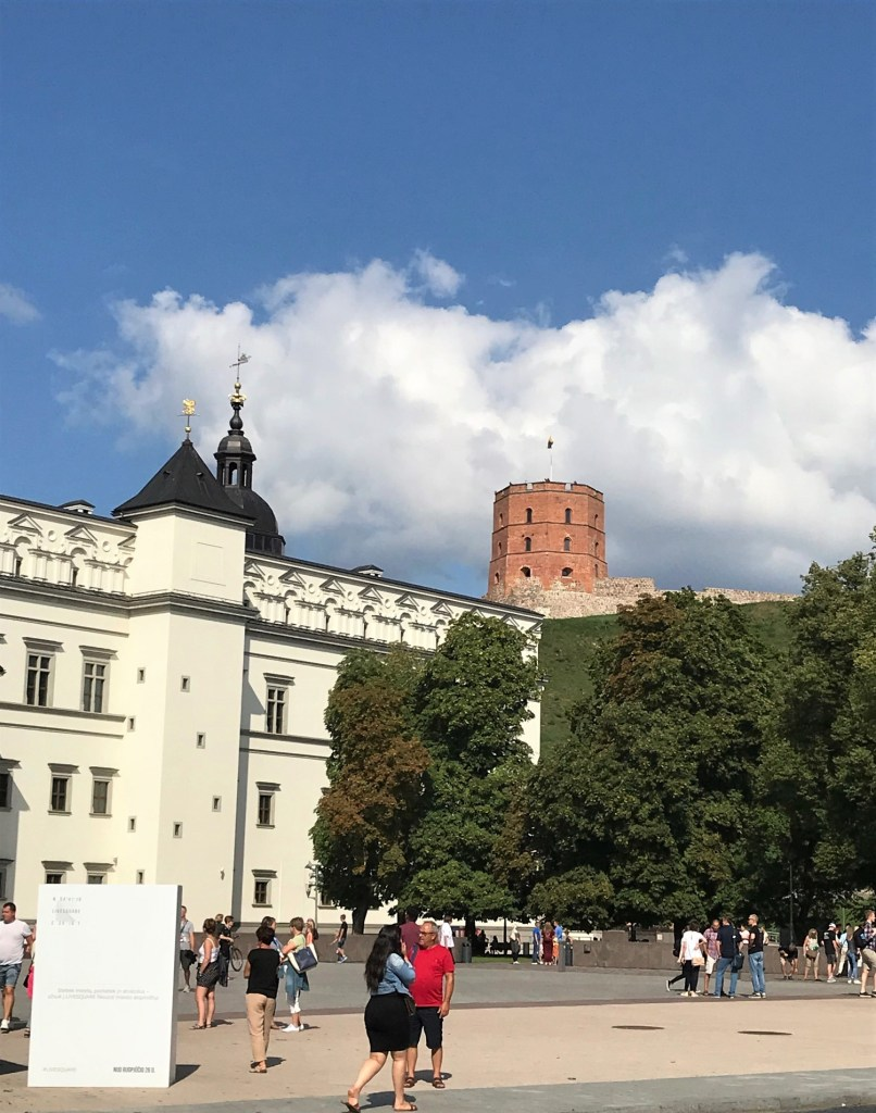 People are walking around Cathedral Square in Vilnius