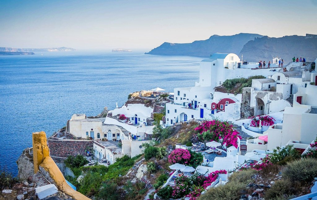 image of Santorini island with houses on slope of mountain
