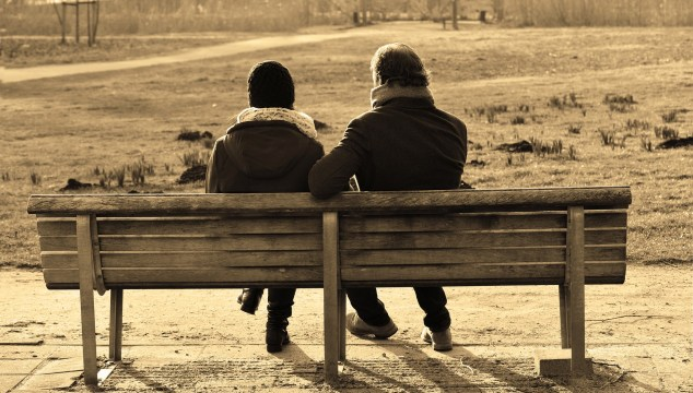 a couple in their 50's on the bench-retirement planning
