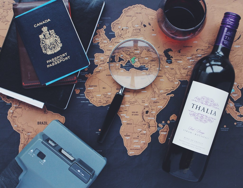 passport, map on the table - travel in retirement