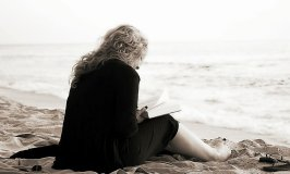 a woman reading a book -what to do in retirement