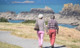 older couple walking - live well on less money in retirement