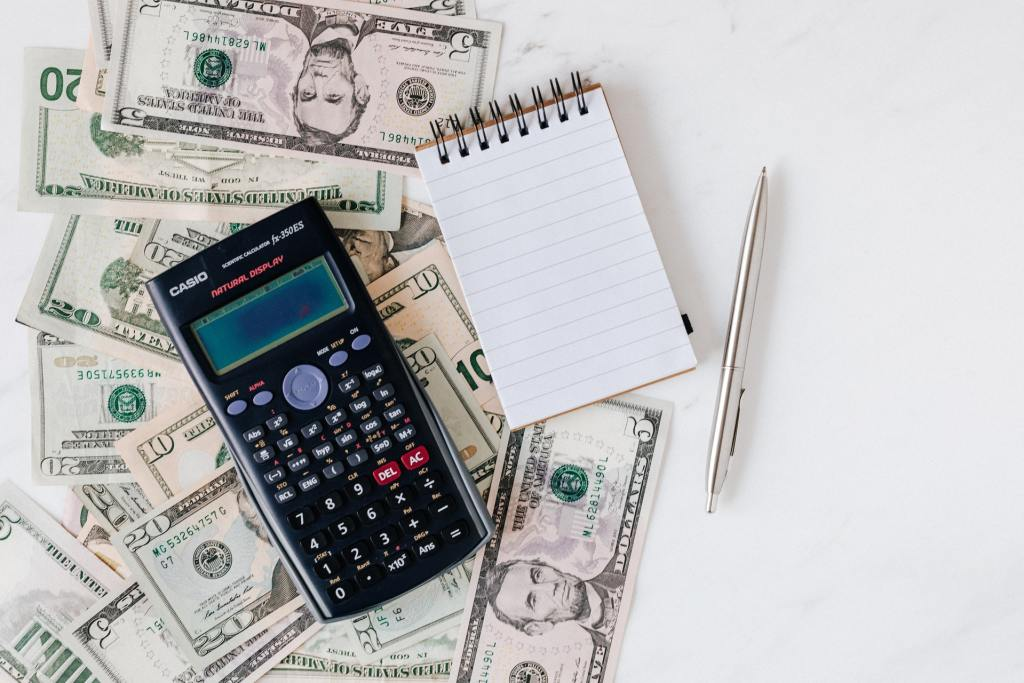 money bills & calculator - know your financial situation