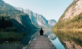 lake surrounded by mountains - alternatives to traditional retirement