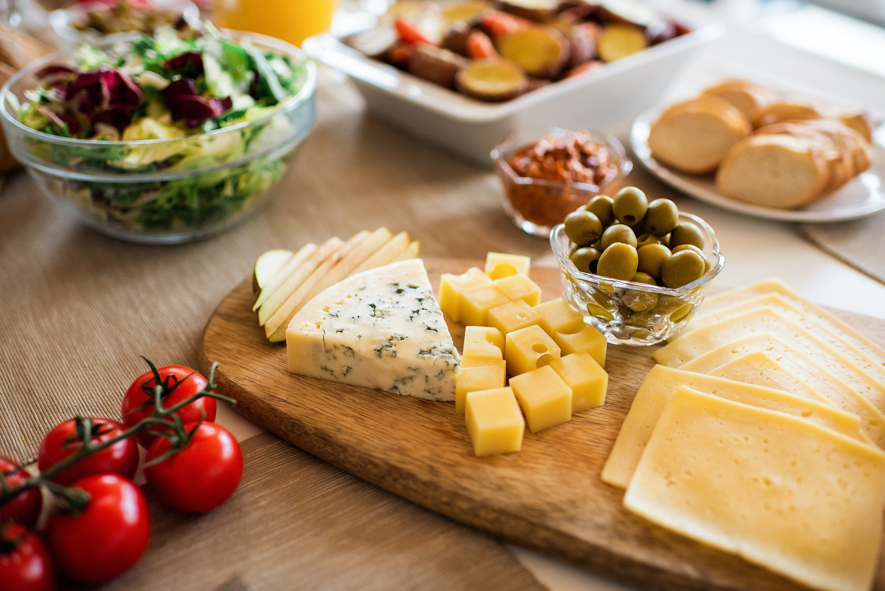 variety of snack on table - cut the costs of food on retirement travel budget