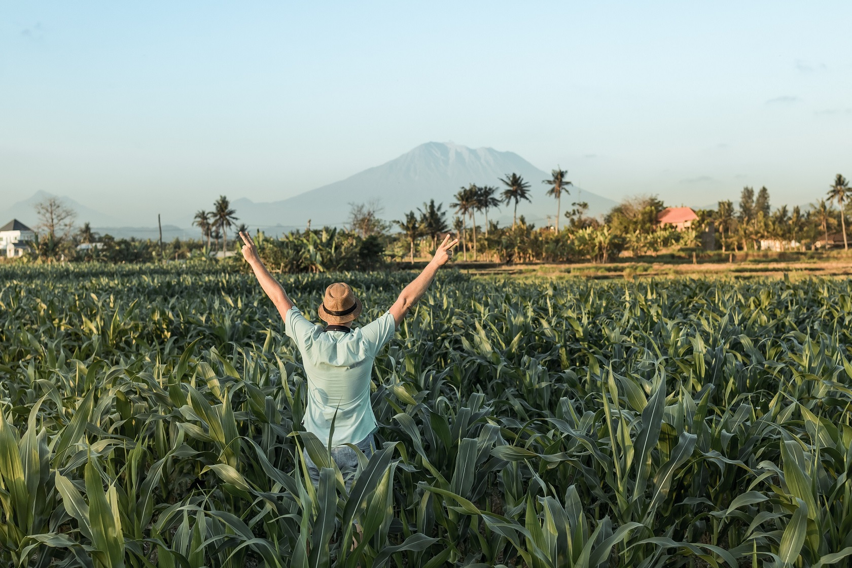 man in the field - travel on a budget in retirement