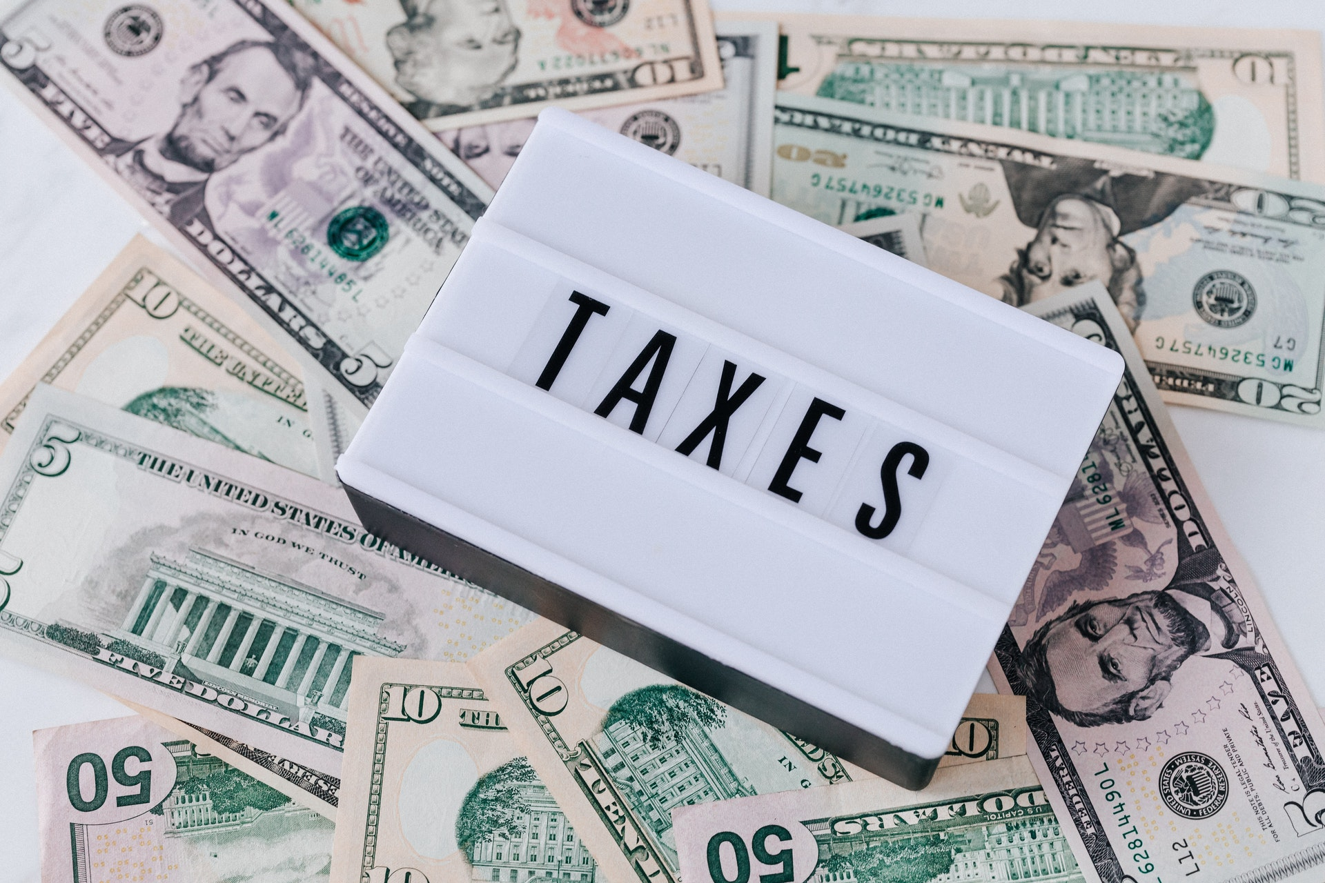 American dollars on a table - prepare tax strategy in your 60s