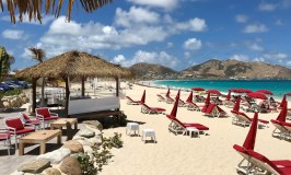 ocean beach with red umbrellas - retirement planning tips