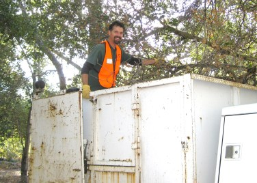 Dave Poeschel loads the truck.