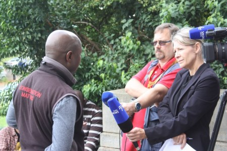 Sinegugu Zikulu being interviewed by the SABC - photo by Rob Symons
