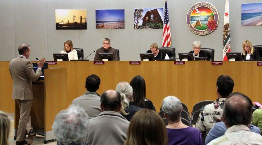 """Attorney Felix Tinkov (l.) addresses the City Council on February 24 about the changes he and his client Don McPherson would like to see in the """"Right of Entry"""" agreement between the city and the Encinitas Arts, Culture and Ecology Alliance."""