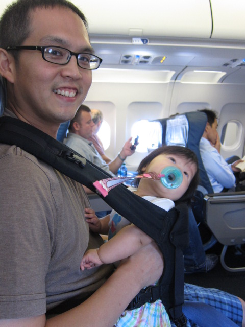 Our first class seat BOS-JFK. Notice the overstimulated baby