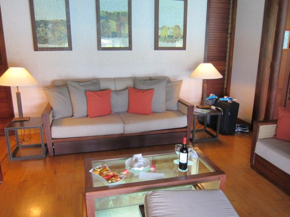 View of the living room set up with fruit and wine