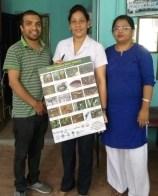 Babita Bajimaya, Emergency Encharge, and Dr. Shakuntala Gupta, Lumbini Zonal Hospital, Rupandehi, being handed over Poster