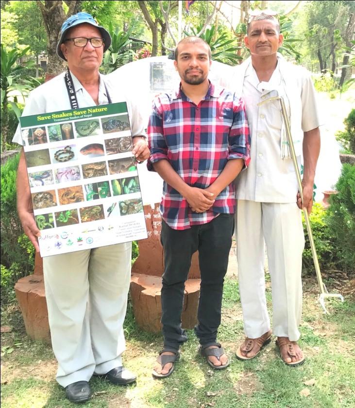 Baburam Aryal, President, and Khimlal Pandey, Secretary, Shankarnagar Ban Bihar and Research Centre, Rupandehi being handed over Poster