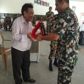 Dr. Chhabilal Thapa receiving a Token of Love from Lieutenant Colonel Sameer Pratap Jung Rana after the awareness program