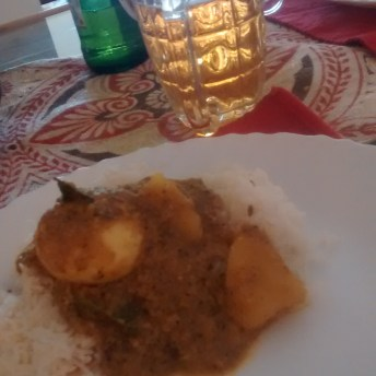 home cooking: egg curry, rice and beer