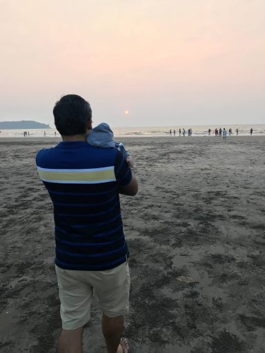 Naren with our son on beach