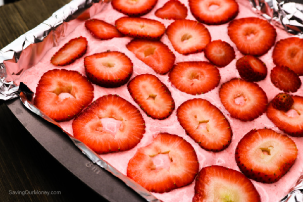 Top with sliced strawberries