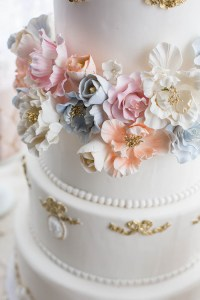 Wedding cake with orange, pink, white and blue flowers