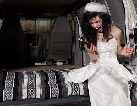 Bride yelling into cell phone from back of limo