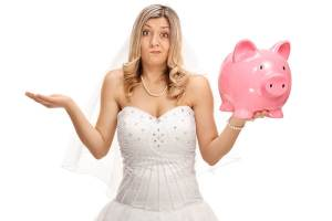 Bride holding piggy bank shrugging