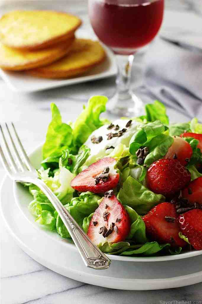 butter lettuce salad with strawberries and cocoa nibs