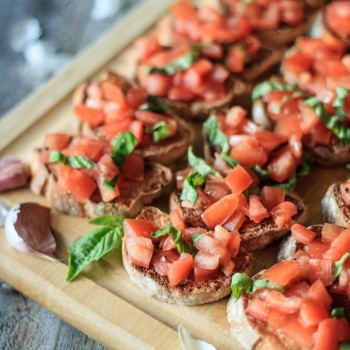 Easy Tomato and Basil Bruschetta: this easy recipe for a classic Italian appetizer is a perfect finger food for a crowd! Slices of toasted baguette topped with fresh tomatoes and basil? You can't go wrong! | www.savortheflavour.com #tomatoes #Italian #appetizers #vegetarianrecipe #basil