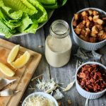 Classic Homemade Caesar Dressing: an easy recipe for traditional, creamy dressing flavored with lemon, garlic, anchovies, Worcestershire sauce, and Parmesan cheese. This simple dressing will transform your Caesar salad into something amazing! | www.savortheflavour.com #caesarsalad #saladdressing #recipe #lemon #garlic