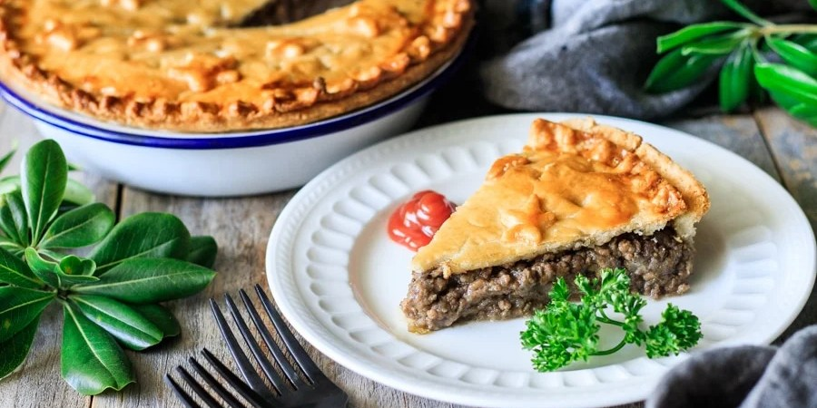 slice of French Canadian meat pie on a plate