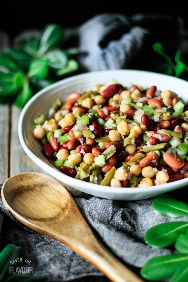 bowl of three bean salad with a spoon