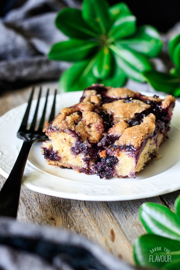 slice of peach and blueberry boy bait with fork