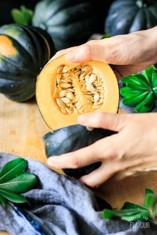 pulling the halved acorn squash apart