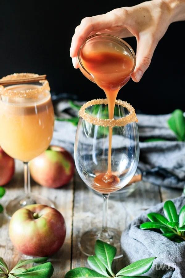 pouring caramel sauce to make a caramel apple mocktail