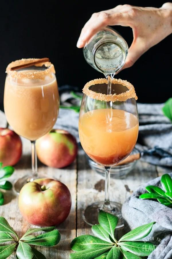 pouring ginger beer to make a caramel apple mocktail