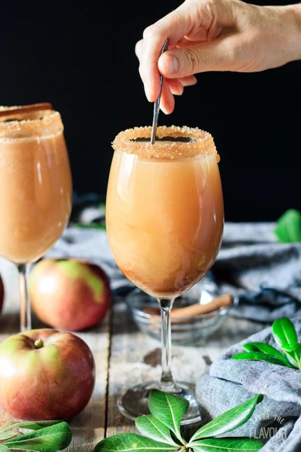 stirring a caramel apple mocktail