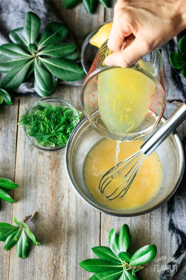 pouring lemon juice into eggs for Greek lemon chicken soup