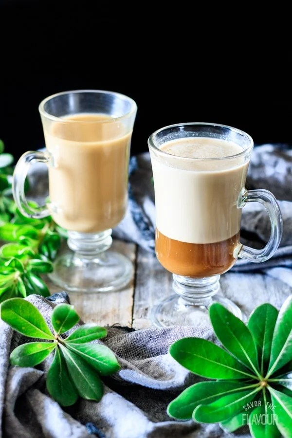 butterscotch sauce, coffee, and cream in a glass for smoked butterscotch latte