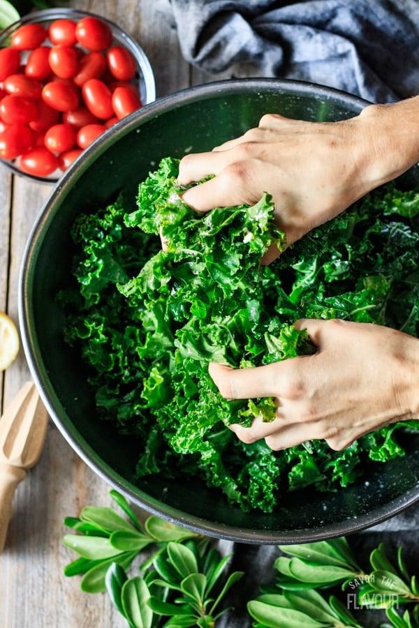 massaging kale for Christmas wreath salad