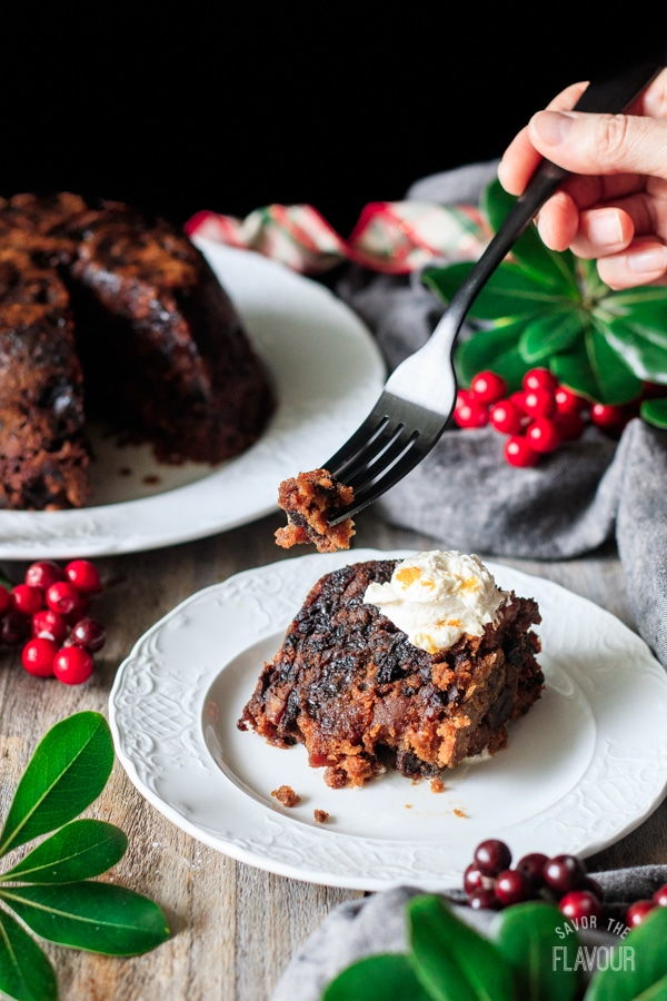 holding a forkful of plum pudding with brandy butter