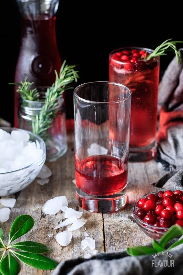 cranberry juice into glass for sparkling cranberry mocktail