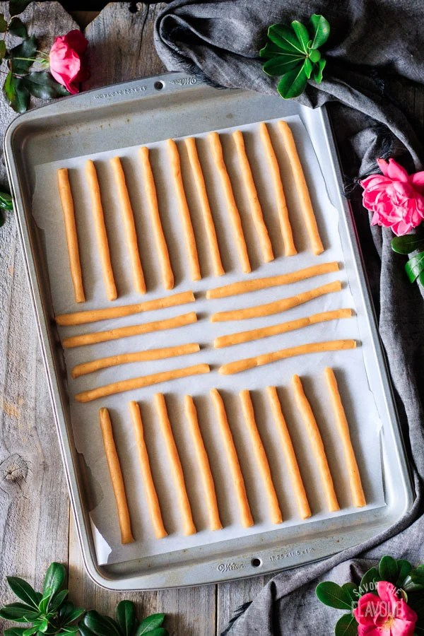 unbaked Southern cheese straws on a cookie sheet