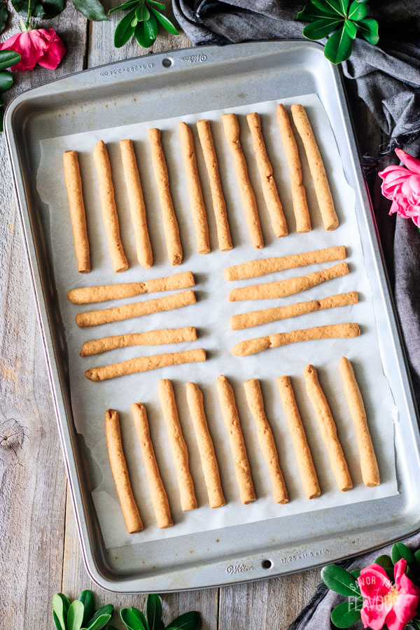 Southern cheese straws on a cookie sheet