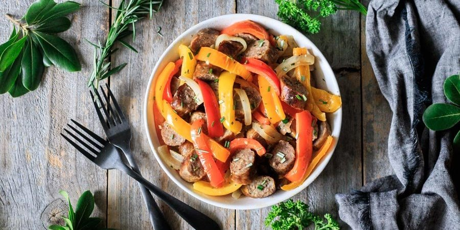 bowl of Italian sausage, peppers, and onions with forks