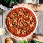 holding a bowl of stuffed pepper soup
