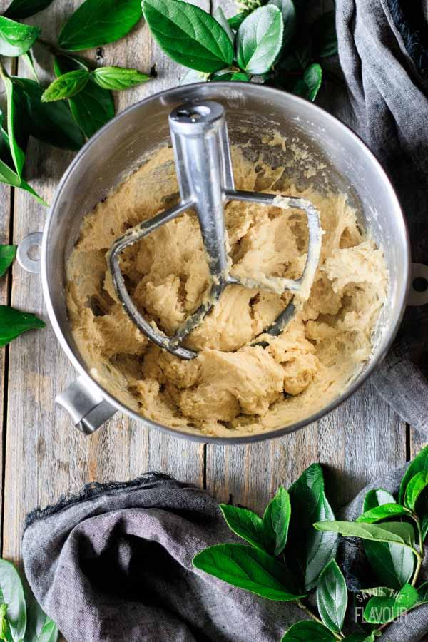 adding liquid to challah bread dough