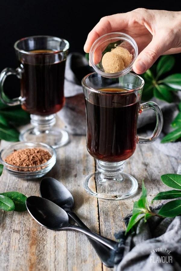 dumping sugar into non alcoholic Irish coffee